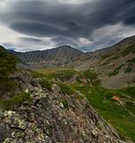 Lenticular clouds in the mountains. Of the reserve Kony Peninsula Royalty Free Stock Image