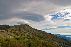 Lenticular clouds over the Montseny. Mountains Stock Image