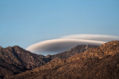 Lenticular clouds over mountain Royalty Free Stock Images