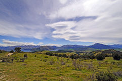 Lenticular Clouds over the Mountains Stock Photography