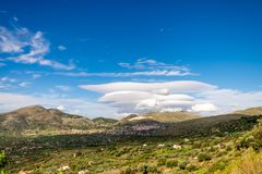 Lenticular clouds under the Mount Etna. Catania. Sicily royalty free stock photography
