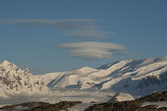 Lenticular obloka over Antarctica. Lenticular obloka over Antarctica on a sunny winter day Royalty Free Stock Photo