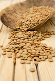 Lentil. Seeds on a wooden background Stock Photo