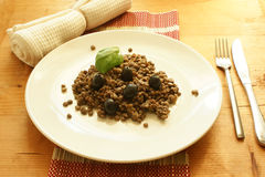 Lentil with black olive and basil leaf Royalty Free Stock Image
