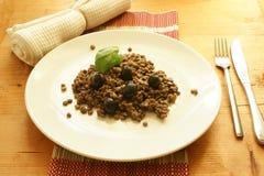 Lentil with black olive and basil leaf Royalty Free Stock Image