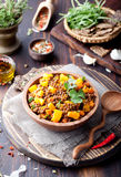 Lentil with carrot and pumpkin ragout in a wooden bowl. royalty free stock photo