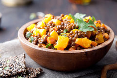 Lentil with carrot and pumpkin ragout in a wooden bowl. Stock Photography