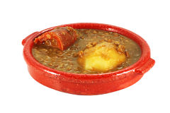 Lentil Casserole. Lentil stew with potatoes and sausage cut with work path Stock Photo