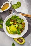 Lentil curry salad with broccoli and avocado on white background. Lentil green curry salad with broccoli and avocado. Healthy vegan food concept Stock Photos