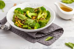 Lentil curry salad with broccoli and avocado on white background. Lentil green curry salad with broccoli and avocado. Healthy vegan food concept Royalty Free Stock Photos
