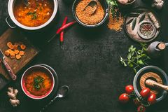 Lentil dishes food background. Lentil soup with cooking ingredients on dark rustic kitchen table background, top view. Healthy stock image