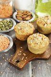 Lentil muffins on the table. Lentil muffins with pumpkin seeds and almonds Stock Photography