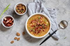 Lentil pea soup garnish with bacon, onion and croutons. Stock Images