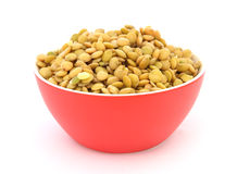 Lentil in red bowl Stock Photos