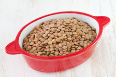 Lentil in red bowl Stock Photography