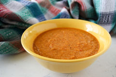 Lentil red cream soup in yellow plate Stock Images