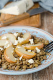 Lentil salad with caramelized pears and blue cheese selective fo Stock Photo