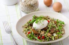 Lentil salad with poached egg Stock Images