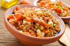 Lentil salad on a rustic wooden table Stock Photos