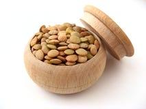 Lentil Seeds. In wooden pot over white Stock Image