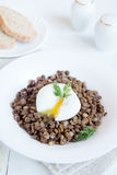 Lentil and soft poached egg Stock Photography