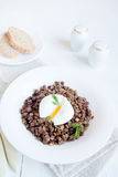 Lentil and soft poached egg Royalty Free Stock Image
