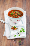 Lentil soup. Brown lentil soup in a bowl on the table, selective focus Royalty Free Stock Images