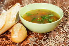 Lentil soup with baguette. Royalty Free Stock Images
