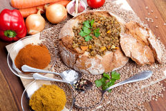 Lentil soup with bread, curry, vegetables Stock Photo