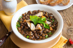 Lentil soup with chicken. And vegetables in white bowl close up Stock Photography