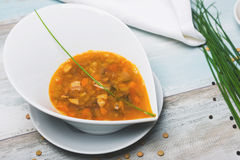 Lentil soup with chorizo and vegetables on a Stock Images
