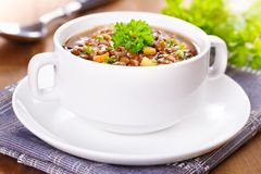 Lentil soup. Fresh homemade lentil soup with potatoes and carrots Stock Photos