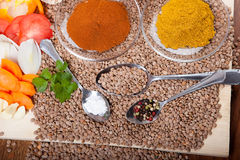 Lentil soup ingredients, curry spice, tomatoes, onion, sweet pepper on wooden board Royalty Free Stock Images