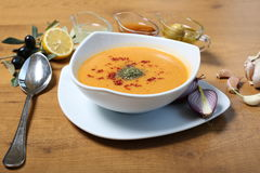 Lentil soup. Lentile soup with olive oil and olives on the wooden table Royalty Free Stock Photos