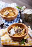 Lentil soup with mushrooms. Two plates of lentil soup on a wooden table royalty free stock photo