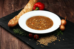 Lentil soup with pita bread in a bowl stock image
