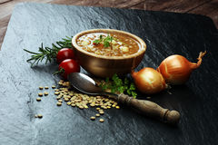 Lentil soup with pita bread in a bowl stock photo