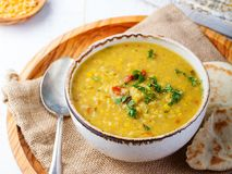 Lentil soup with pita bread in a ceramic white bowl on a wooden background. Close up. stock photos