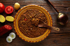 Lentil soup plate Mediterranean recipe aged wood Royalty Free Stock Image
