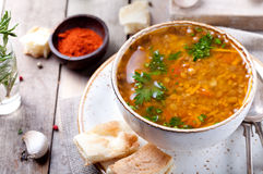Lentil soup with smoked paprika and bread. In a ceramic bowl on a wooden background Stock Image