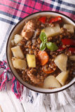 Lentil soup with vegetables and meat close up. vertical top view Royalty Free Stock Photos