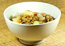 Lentil soup in a white bowl with brown background Stock Photo