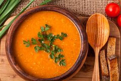 Lentil soup. In a wooden dish Royalty Free Stock Image