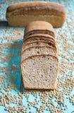 Lentil sourdough bread. On a blue table board royalty free stock photo
