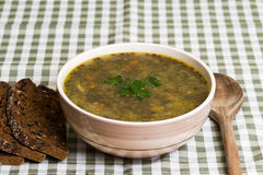Lentil stew with bread Stock Photos