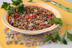 Lentil stew with smoked sausage Stock Image