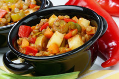 Lentil stew with vegetable in black pot Royalty Free Stock Photography