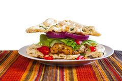Lentil Turkeyburger on Naan. Curried Lentil Turkeyburgers on garlic naan with tomato, red onion and lettuce Stock Images