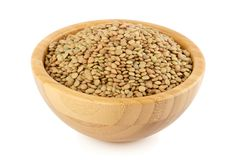 Lentil in a wood bowl Royalty Free Stock Images