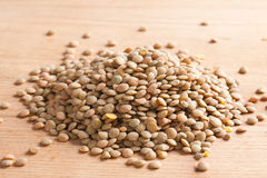 Lentil on wooden table Stock Image
